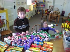 children assembling bags
